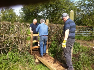 Jeff and Richard securing the new stile under Peter's supervision